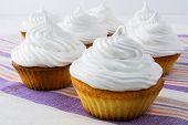 White cupcakes on the linen napkin. Sweet pastry. Sweet dessert. Birthday cupcakes. Homemade cupcake. Sweet cupcake. Gourmet cupcakes. poster