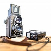 old twin-lens reflex camera with light meter on the white background poster