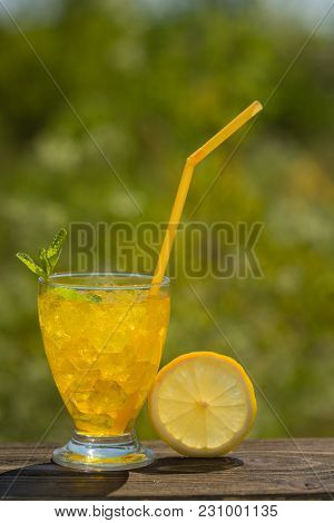 A Glass Of Soda Water On An Old Board, On Nature, Ice, Bubbles, Grapefruit, Spike