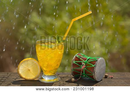 A Glass Of Soda Water On An Old Board, On Nature, Ice, Bubbles, Grapefruit, Spike, In The Background