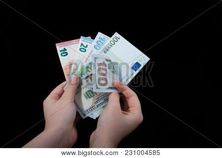 Hand Holding American Dollar  Banknotes Isolated On Black Background