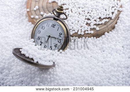 Retro Pocket Watch On White Polystyrene Balls