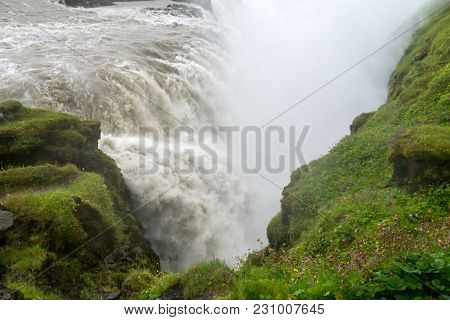 Gullfoss,  Most Spectacular Waterall, Two Cascades On The Hvita River Tumbling Into A Deep Gorge. Ic