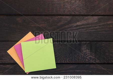 High Angle Photo Of Reminder Stickers On Wood.