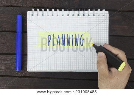 Human Hand Writing On Notepad Inscription: Planning.