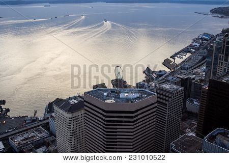 Birds-eye View On The Water Scape With Boats And Yachts And High Rise Buildings Of A Big City