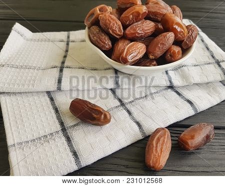 Dates On A Black Wooden Towel View, Top, Towel