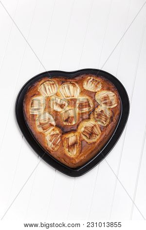 Heart Shaped Apple Pie On White Background