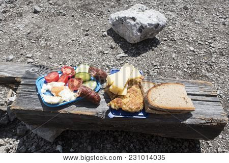 Closeup Of Mountaineers Snack On Wood In Summer
