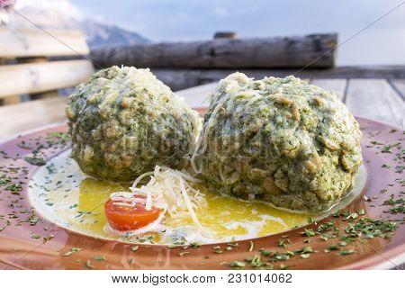 Closeup Of Austrian Spinach Dumplings On A Table