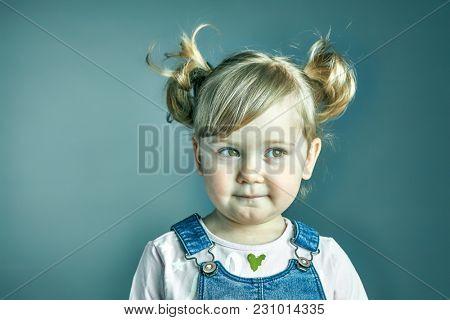 studio shot portrait of female thinking child