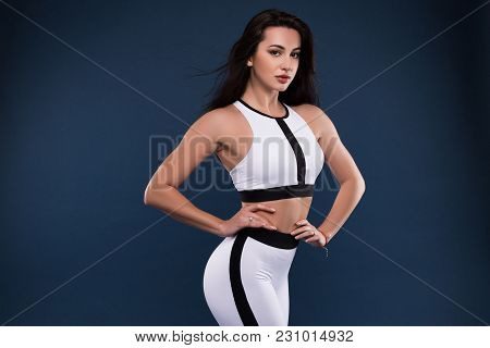 Keep In Shape For Your Benefit! Picture Of The Attractive Young Fit Woman On Dark Blue Background Po