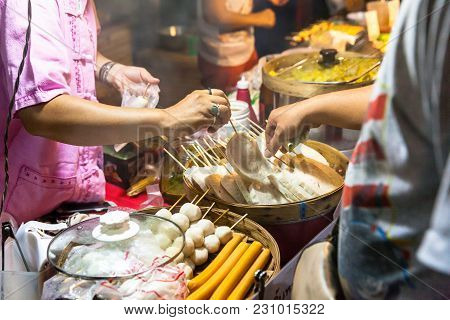 Chiang Mai, Thailand - August 21: Man Buys Street Food At The Sunday Market (walking Street) On Augu