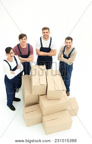 Happy smiling movers carrying boxes, isolated on white background