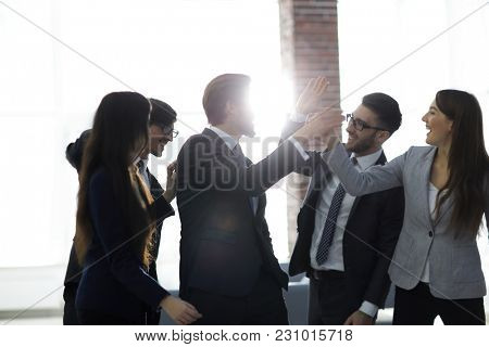 Portrait of an enthusiastic business team congratulating 2