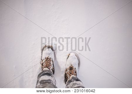 Image Of Man's Feets In Boots In Snow