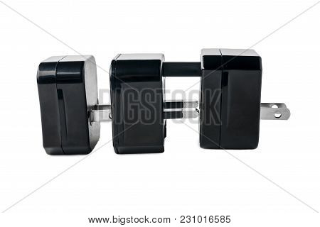 Three Black Adapters For American And European Plug On White Isolated Background