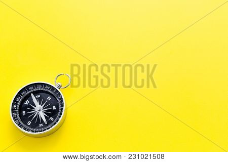 Direction Concept With Compass On Yellow Table Background Top View Mockup