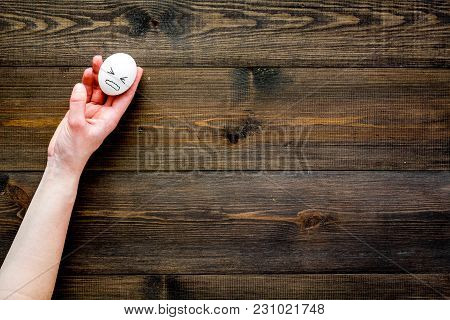 Emotion Management Concept. Suppression Anger. Angry Face Drawn On Egg. Wooden Background Top View.