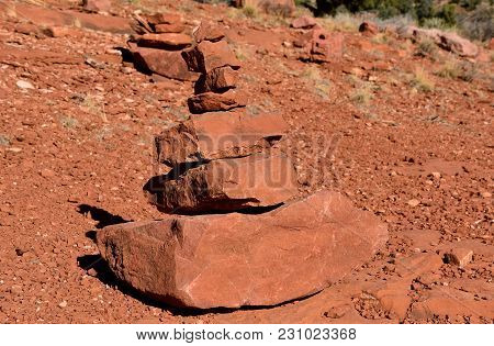 Various Rocks Of The Red Rock Mountains Stacked By Size In The Sedona, Arizona Area.