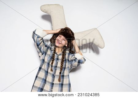 Happy Young Girl From Russia In A Warm Fur Hat Holds Gray Winter Boots