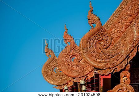 Intricate Detail Of Gable End Carved In Wood In Thai-lanna Architectural Style.