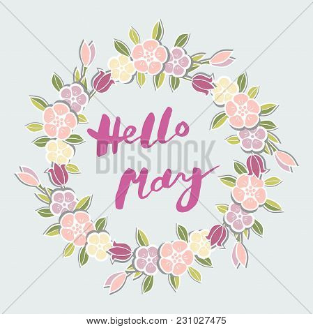 Handwritten Lettering Hello May Isolated On Background With Flower Wreath. Lettering Hello May As Lo