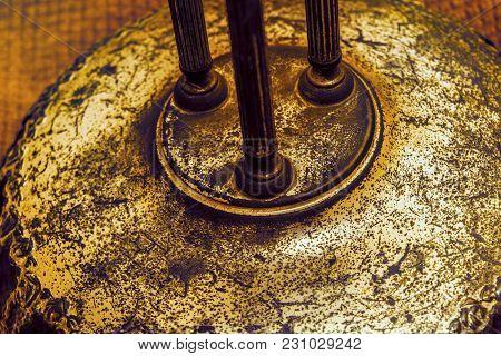 Antique Rustic Bronze Decorative Relief Detail. Close Up Vintage Metallic Pillars On A Circular Pede
