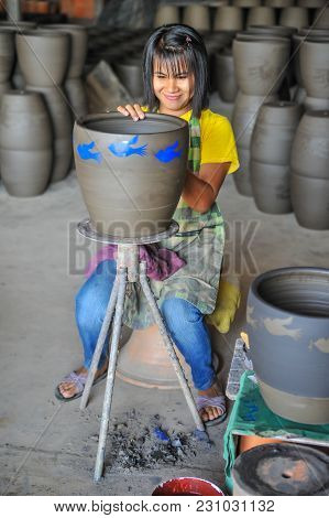Nakhon Sawan, Thailand - December 5, 2011: Woman Artist Screening Graphics Image To Formed Pottery I