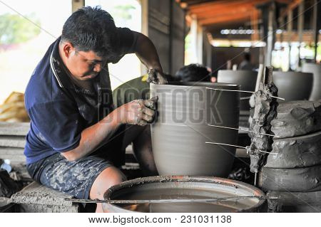 Nakhon Sawan, Thailand - December 5, 2011: Senior Craftsman Making Pottery From Clay By Using Electr