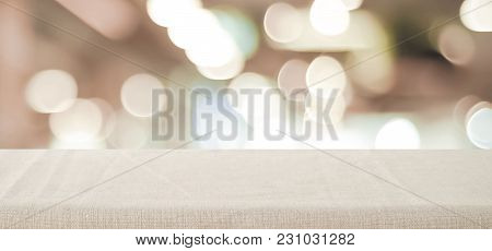 Empty Table With Linen Tablecloth Over Blurred Store With Bokeh Background Banner, Product Display M