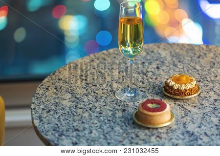 Gourmet Pastries With White Wine In A Room High Above The City