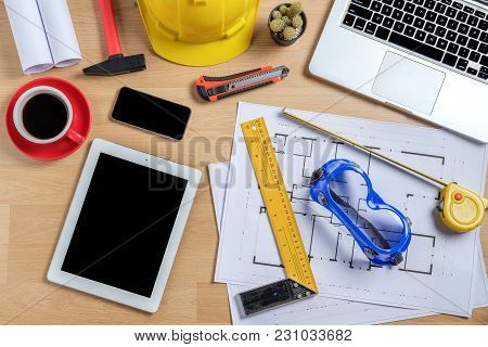 Architectural Office Desk With Laptop,smart Phone,tablet,cup Of Coffee And Engineer Equipment.top Vi