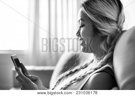 Smiling woman using a smartphone
