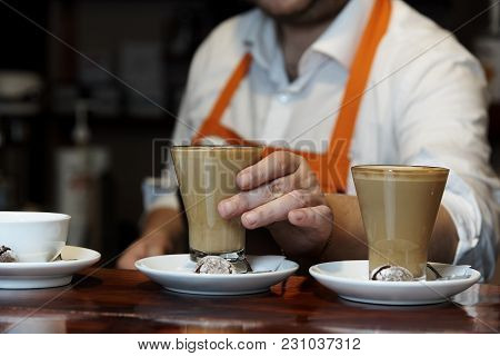 A Coffee Drink Barista Puts On A Saucer With Biscuits.