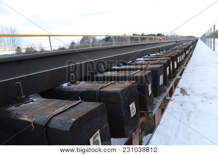 Railway In Winter. Rails And Sleepers - A Road For Locomotives And Electric Locomotive Covered With