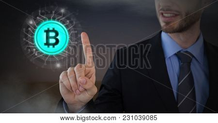 Digital composite of Businessman touching bit coin graphic icon