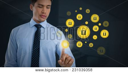 Digital composite of Businessman touching security lock icons