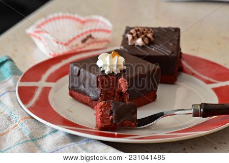 Chocolate Cakes With Decoration On A Black Slate Close Up