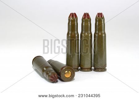 Five Blank Cartridges For Kalashnikov Assault Rifles On White Background Close-up, Scattered