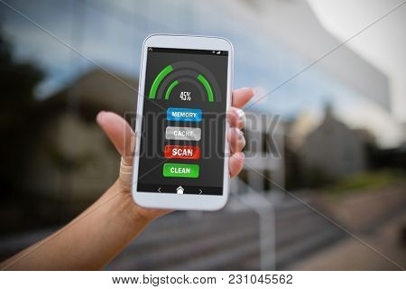 Mobile display with memory cleaner against woman holding mobile phone
