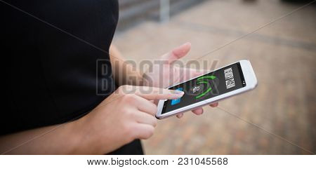 Mobile display with memory cleaner against businesswoman using mobile phone