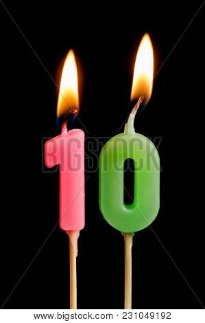 Burning Candles In The Form Of Ten Figures (numbers, Dates) For Cake Isolated On Black Background. T