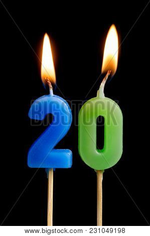 Burning Candles In The Form Of Twenty Figures (numbers, Dates) For Cake Isolated On Black Background