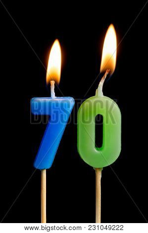 Burning Candles In The Form Of Seventy Figures (numbers, Dates) For Cake Isolated On Black Backgroun