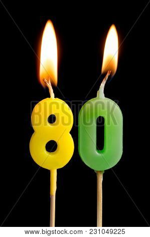Burning Candles In The Form Of Eighty Figures (numbers, Dates) For Cake Isolated On Black Background