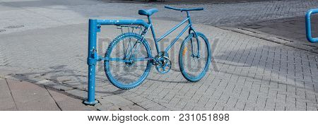 Road Babbier For Cars Made From The Bike Painted In Blue At The City Center Of Reykjavik, Iceland