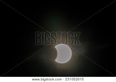 Partial Solar Eclipse On A Cloudy Day