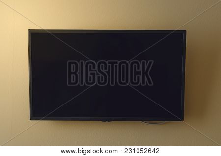 Tv Set With Blank Screen Mounted On Yellow Wall. Tv Template With Copy Space.