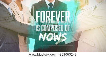 Forever is composed of nows against group of smiling business people piling up their hands together